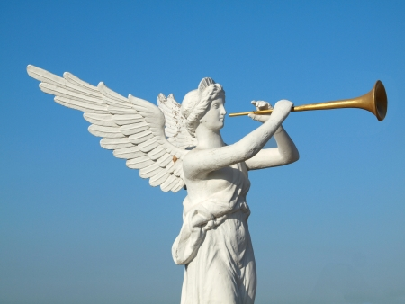 angel gabriel: sculpture of an angel blowing golden horn