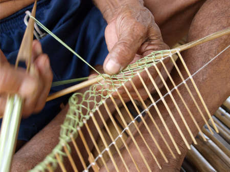 UBON RATCHATHANI, THAILAND  Unidentified fingers of an old man knitting fish net on June 22, 2010 in Khong Chiam, Ubon Ratchathani, Thailand     photo