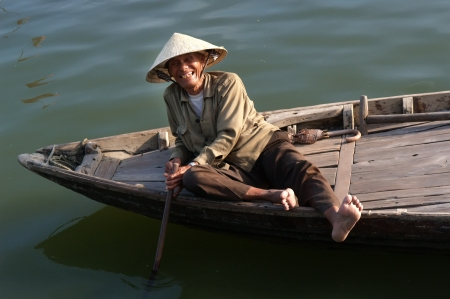 DA NANG, VIETNAM :  Unidentified old Vietnamese smiling in his boat for tourist on April 8, 2008