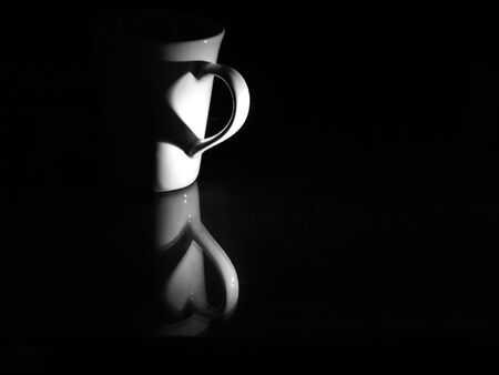 coffee cup with heart shadow
