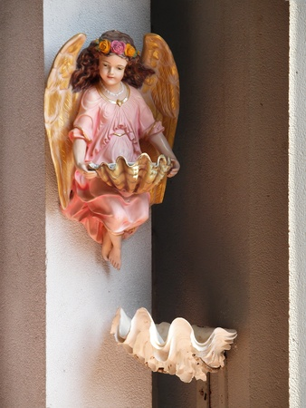 Little angel holding Holy water basin Stock Photo
