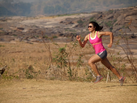 rocky road: a woman running on the rocky road