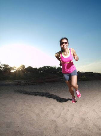 a woman running on the rocky road