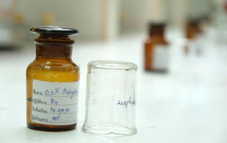 reagent: Reagent bottle amber glassware in lab Stock Photo