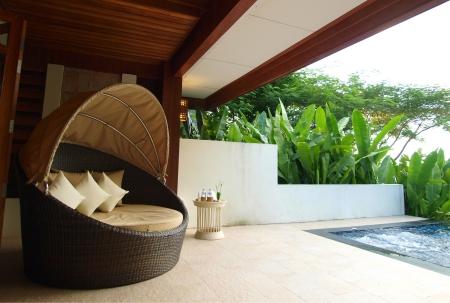 An armchair on luxury resort terrace Foto de archivo