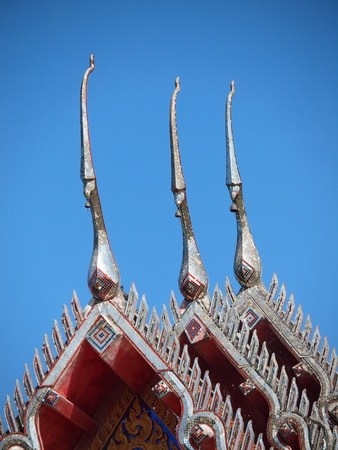 Thai style wooden roof decoration photo
