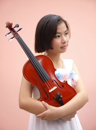 An Asian girl playing violin photo