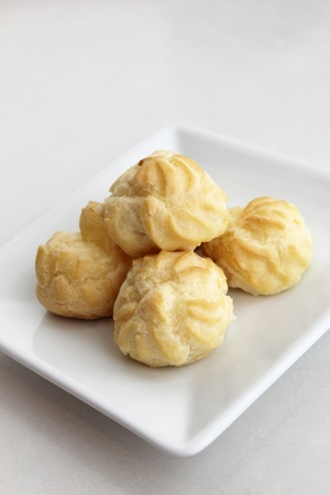 creampuff: Eclairs in a white plate