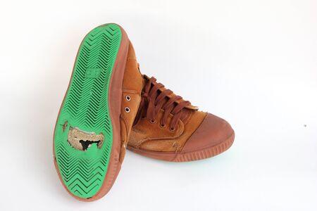 holed: Hole on canvas shoes sole Stock Photo