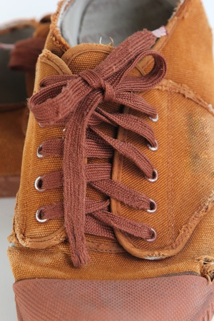 lacing sneakers: Old brown canvas shoes tie