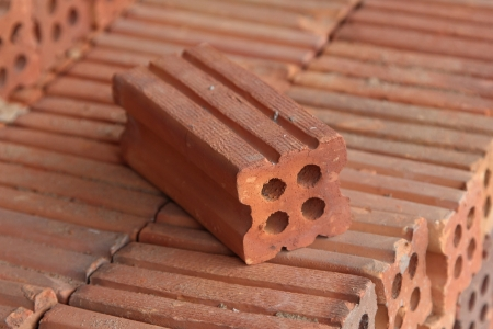 Red bricks material for building construction photo
