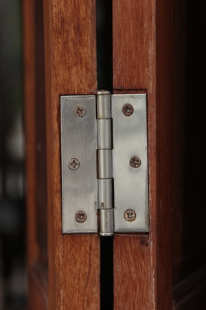 hasp: Metal hasp on wood window