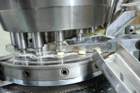 Pharmaceutical machine operating to produce medicine photo