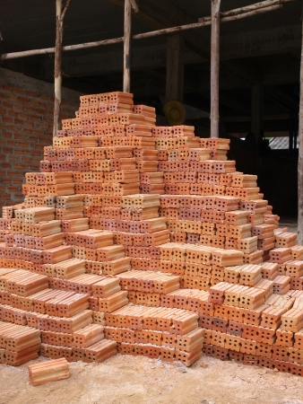 Pile of bricks for construction photo