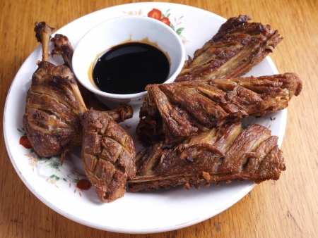 Fried crispy duck with black sauce photo