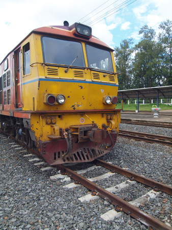 Old diesel locomotive on railway photo