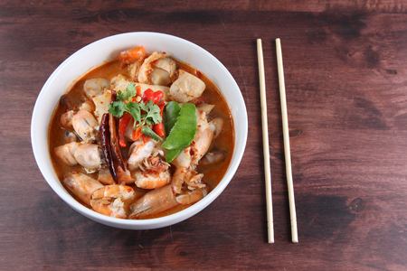 popular soup: Tom Yum Kung Thai popular menu spicy soup with chopstick Stock Photo
