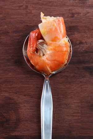 Big size spice prawn in spoon  photo