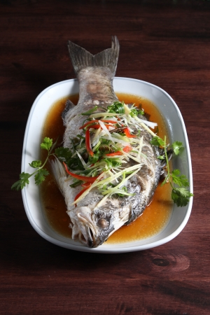 Steamed fish in soy sauce Stock Photo