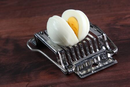 kitchen device: Egg cutting tool convenience device in kitchen Stock Photo