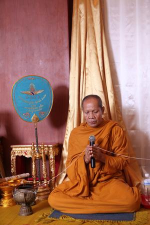 chanting: UBON RATCHATHANI, THAILAND – NOV 9, 2013 : Unidentified Thai monk chanting in wedding ceremony for blessing wedding couple on Nov 9, 2013 in Ubon Ratchathani, Thailand.