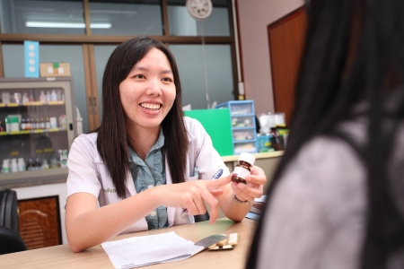 UBON RATCHATHANI, THAILAND – AUG 21, 2013 : Unidentified pharmacist counseling and informing her patient in pharmacy department on Aug 21, 2013 in Sappasitparsong hospital Ubon Ratchathani, Thailand.