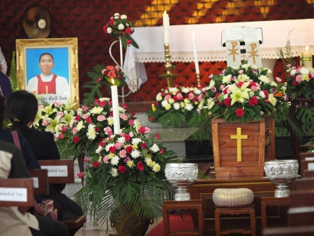 UBON RATCHATHANI, THAILAND – MAR 19, 2012 : Picture and coffin  of priest Luca Santi Wancha in his funeral on Mar 19, 2012 in Ubon Ratchathani, Thailand Editorial