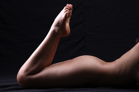 Transgender model nude pose in studio