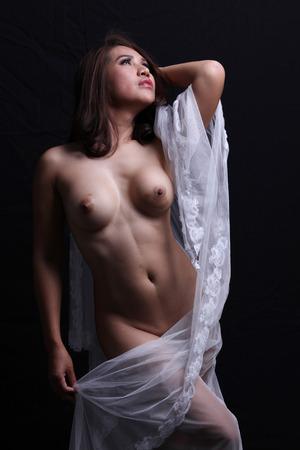 nude pose: Transgender model with bridal veil nude pose in studio