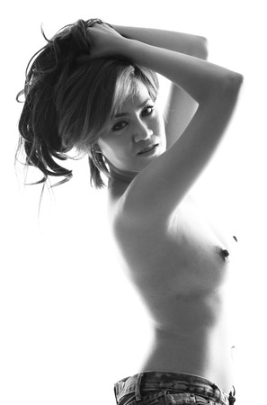 Asian model topless in sexy pose photo