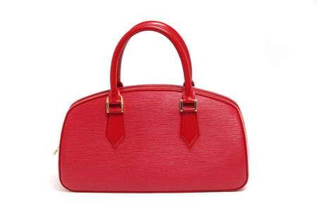 Woman red leather handbag isolated white background photo