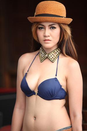 bikini model: Asian woman in bikini and collar