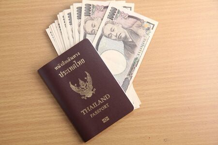 banknote: Japanese Yen banknote and Thai passport