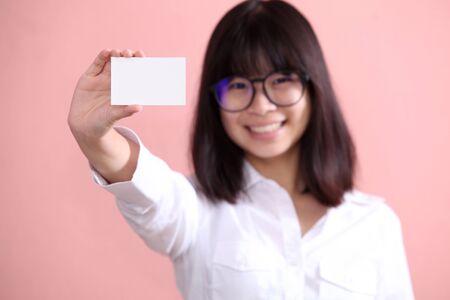 Asian girl holding blank sheet