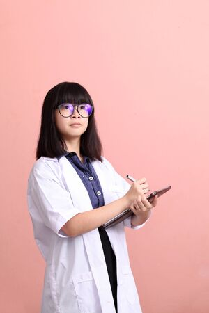 Young Asian scientist taking note on tablet Stock Photo