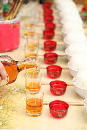 ancestor: Whisky pouring for ancestor food offering