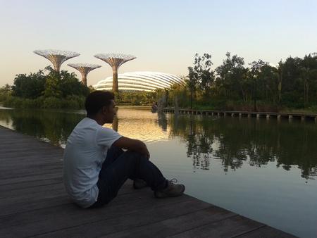 beside: Man sitting beside lake, Singapore