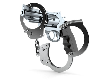 Gun with handcuffs isolated on white background Stock Photo