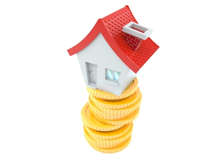 House with coins isolated on white background Stock Photo