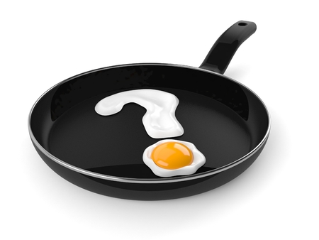 Frying pan with egg in question mark shape isolated on white background