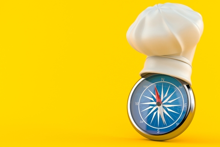 Cooking hat with compass isolated on orange background