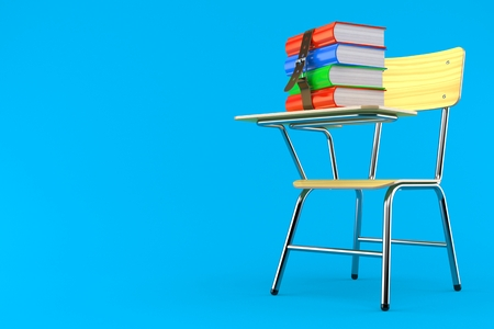 Books on school chair isolated on blue background Reklamní fotografie
