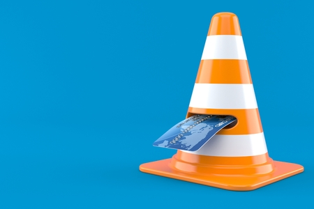 Credit card with traffic cone isolated on blue background Stock Photo
