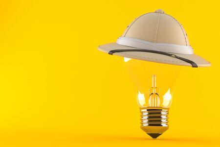 Pith helmet with Light bulb isolated on orange background Reklamní fotografie