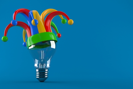 Light bulb with jester hat isolated on blue background Archivio Fotografico