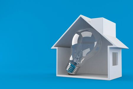 House cross section with Light bulb isolated on blue background Reklamní fotografie