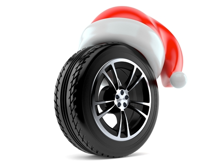 Car wheel with santa hat isolated on white background Stock Photo