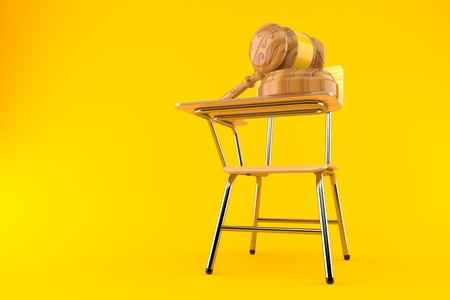 Gavel with school chair isolated on orange background Foto de archivo