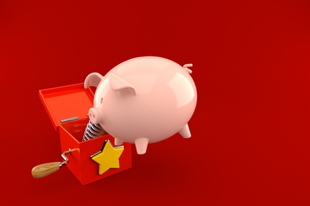 Jack in the box with piggy bank isolated on red background