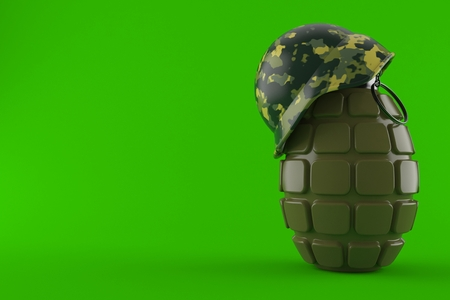 Hand grenade with helmet isolated on green background Stock Photo
